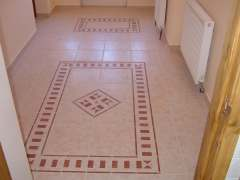 floor tile with mosaics and tile skirting