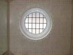 round window with natural stone mosaics